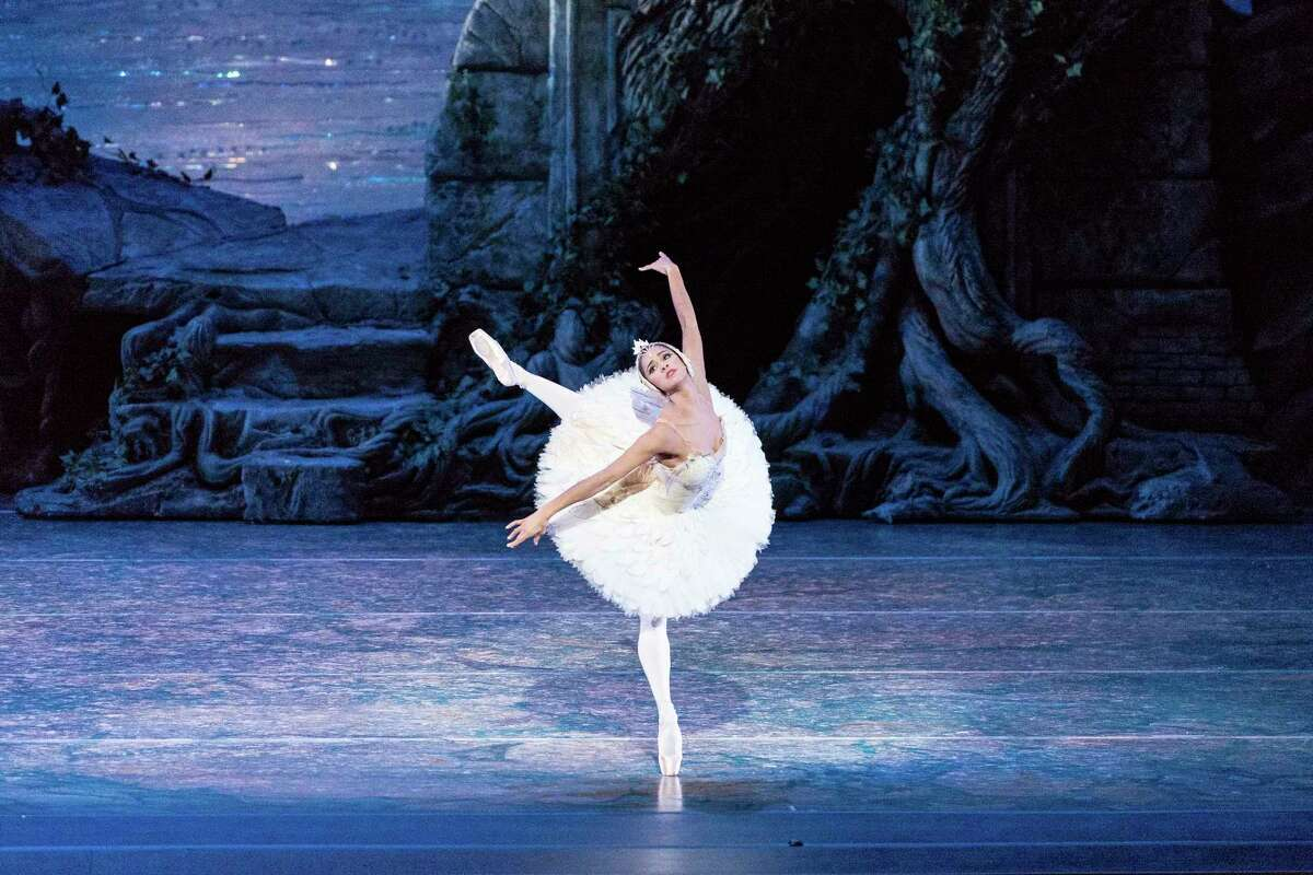 """In this Sept. 3, 2014 file photo, Misty Copeland performs in """"Swan Lake,"""" at the Queensland Performing Arts Centre in Queensland, Australia."""