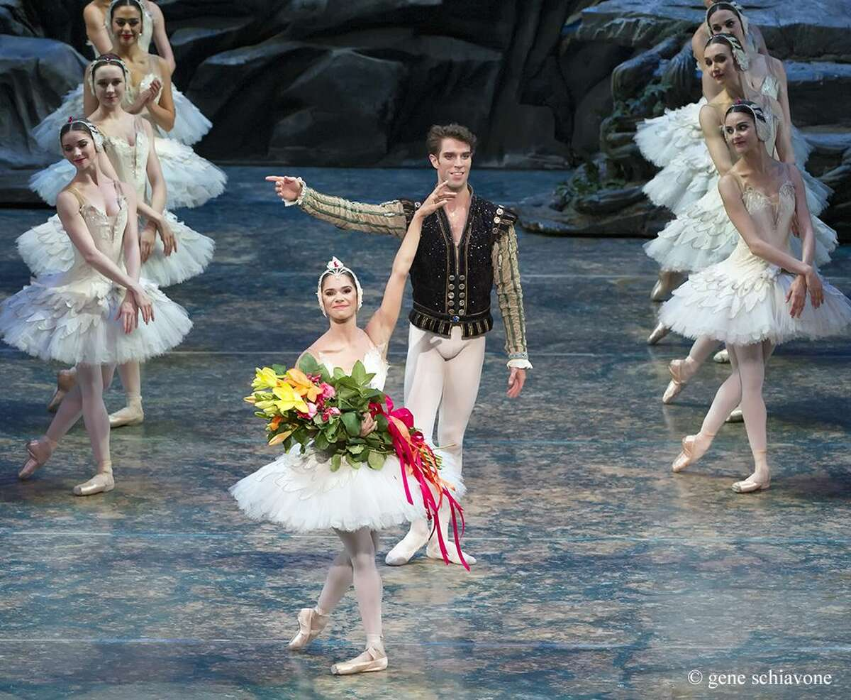 """Misty Copeland and James Whiteside acknowledge the audience after appearing June 24 in """"Swan Lake"""" at the Metropolitan Opera House in New York."""