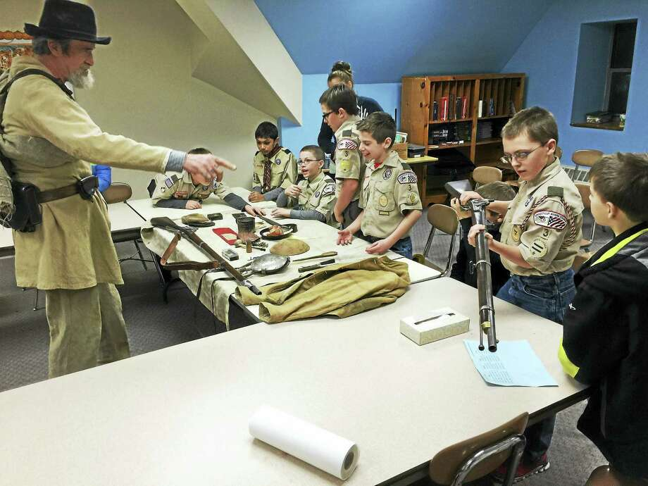 Members of Boy Scout Troop 3 hear from Civil War re-enactors Monday, as they prepare for an upcoming trip to Gettysburg. Photo: BEN LAMBERT — REGISTER CITIZEN