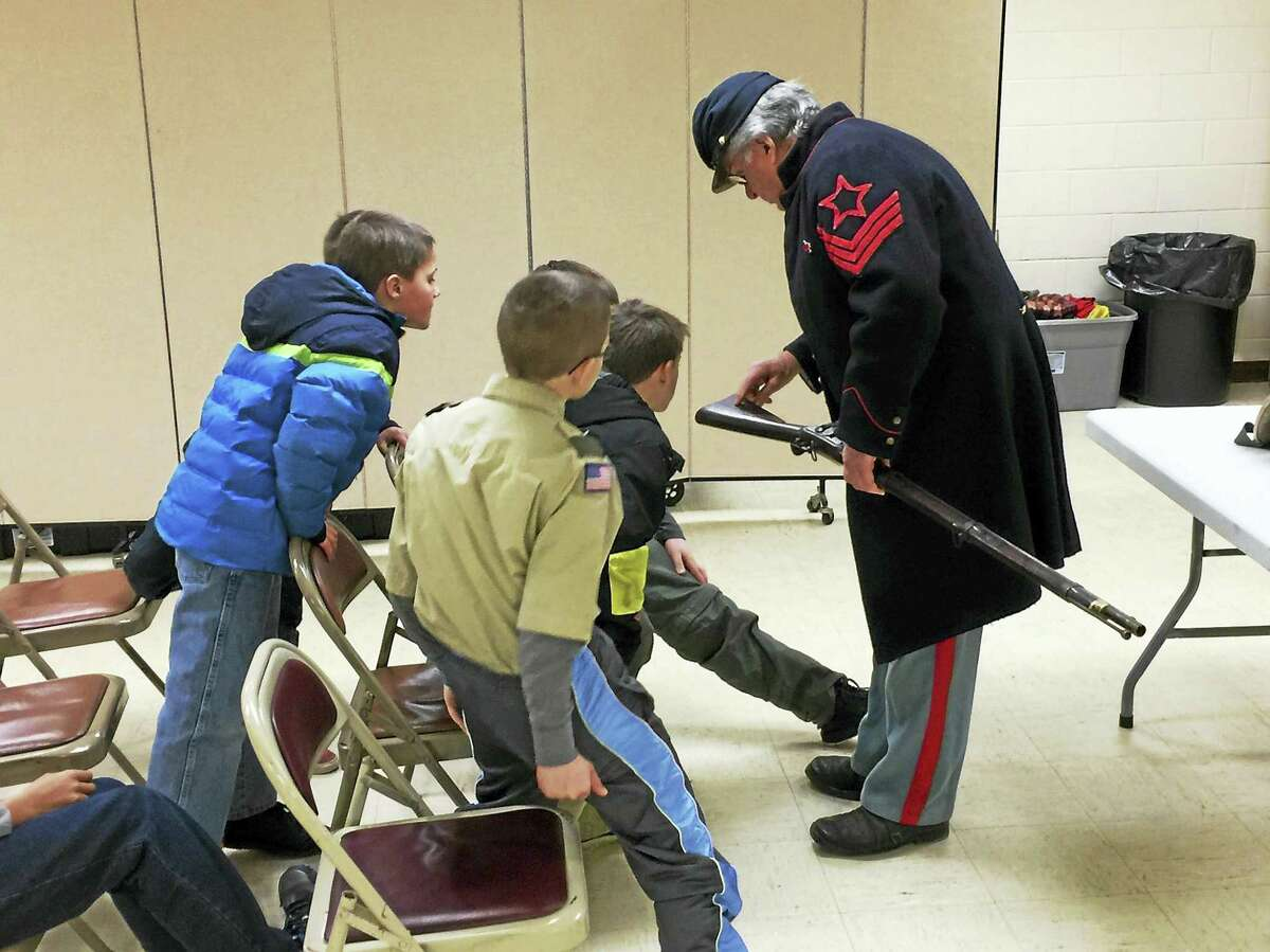 Members of Boy Scout Troop 3 hear from Civil War re-enactors Monday, as they prepare for an upcoming trip to Gettysburg.