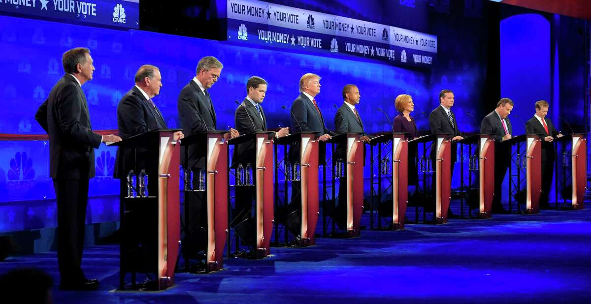Republican presidential candidates, from left, John Kasich, Mike Huckabee, Jeb Bush, Marco Rubio, Donald Trump, Ben Carson, Carly Fiorina, Ted Cruz, Chris Christie, and Rand Paul take the stage during the CNBC Republican presidential debate at the University of Colorado, Wednesday, Oct. 28, 2015, in Boulder, Colo.