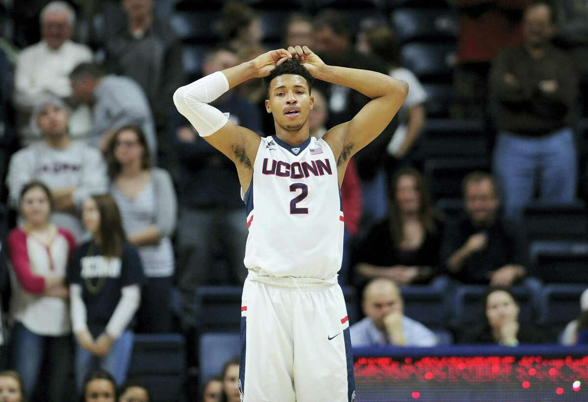 Connecticut's Jalen Adams reacts in the final seconds of the second half of an NCAA college basketball game against Houston, Sunday, Feb. 28, 2016, in Storrs, Conn. Houston won 75-68. (AP Photo/Jessica Hill)