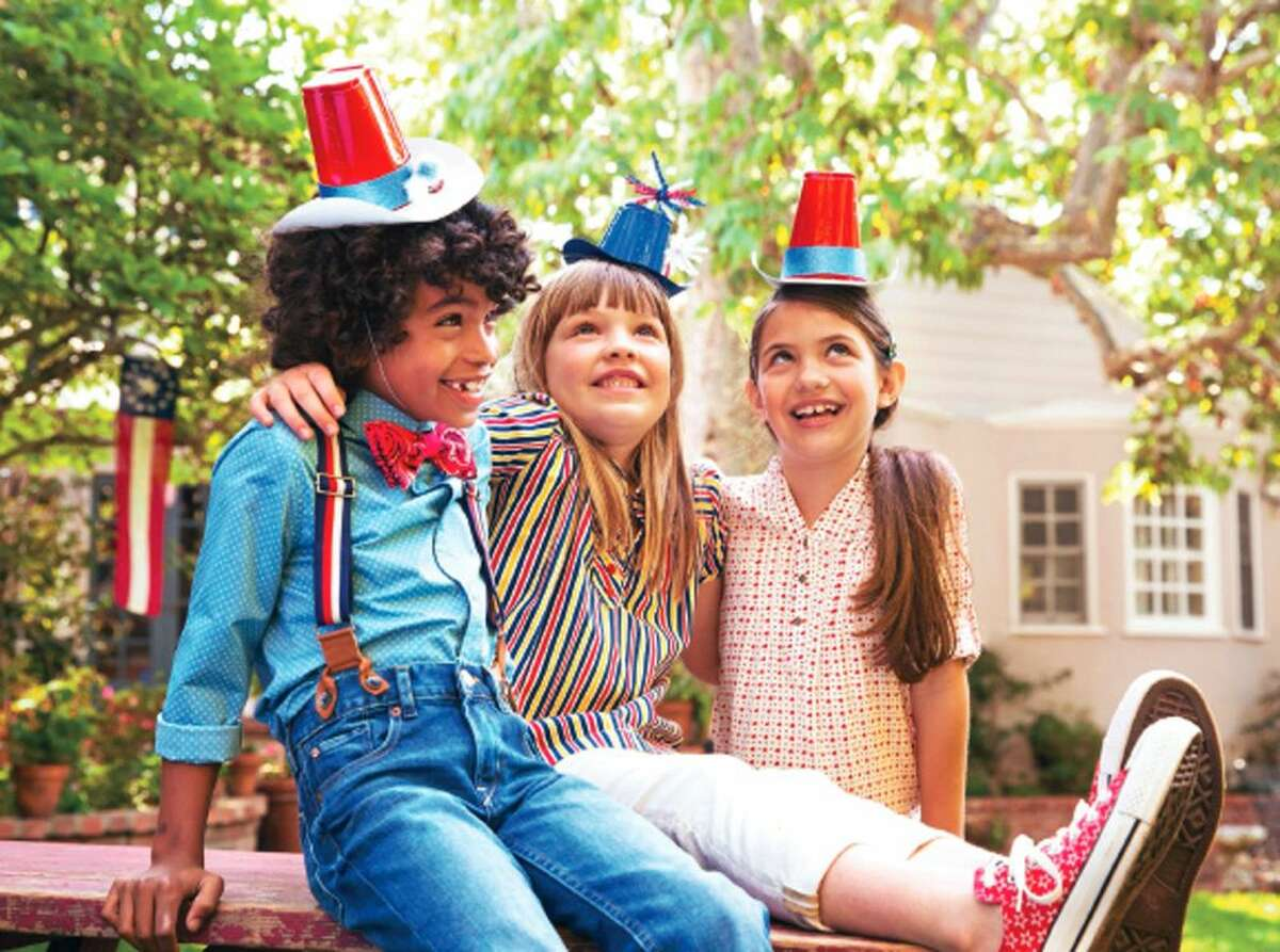 This photo provided by courtesy of FamilyFun magazine shows children wearing handcrafted caps made from plastic cups for celebrating Fourth of July.