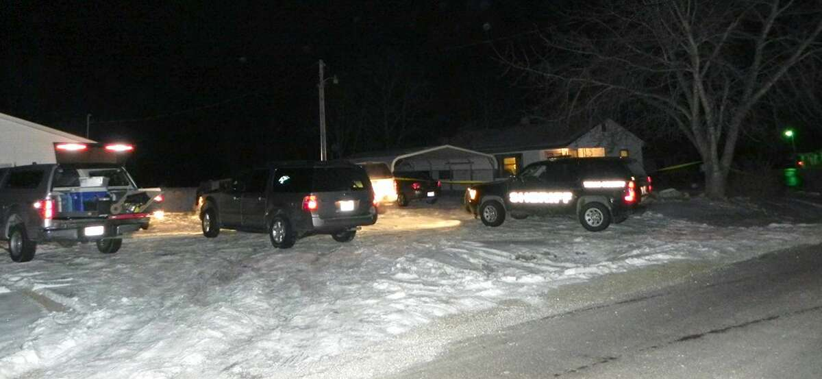 Authorities respond to a house in Tyrone, Mo., at about 5:40 a.m. Friday, Feb. 27, 2015. Authorities say multiple people were shot to death and one was wounded in attacks in a small southeastern Missouri town, and the suspected gunman was found dead from an apparent self-inflicted gunshot wound. (AP Photo/Houston Herald, Doug Davison)