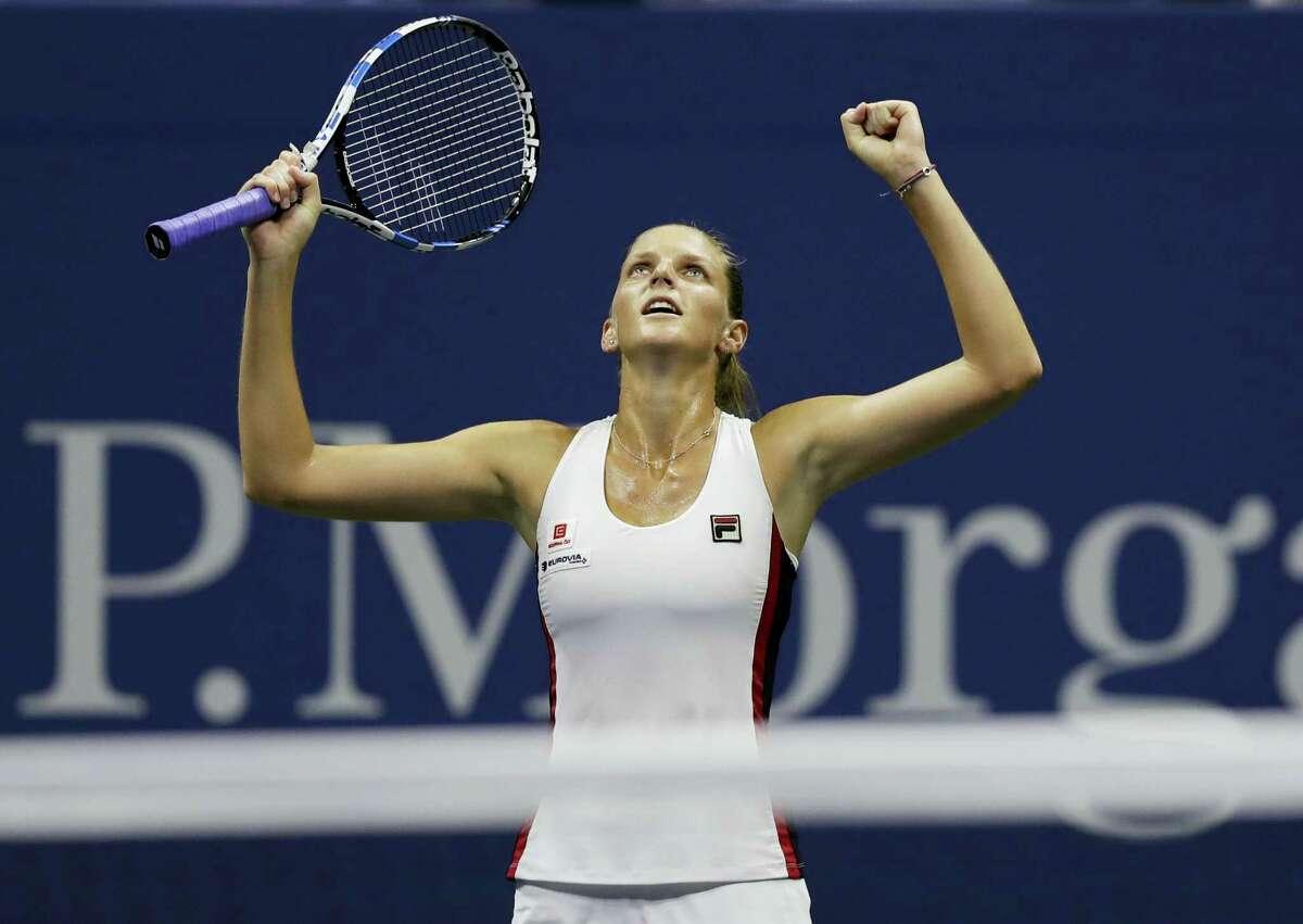 Karolina Pliskova reacts after beating Serena Williams in their semifinal match.