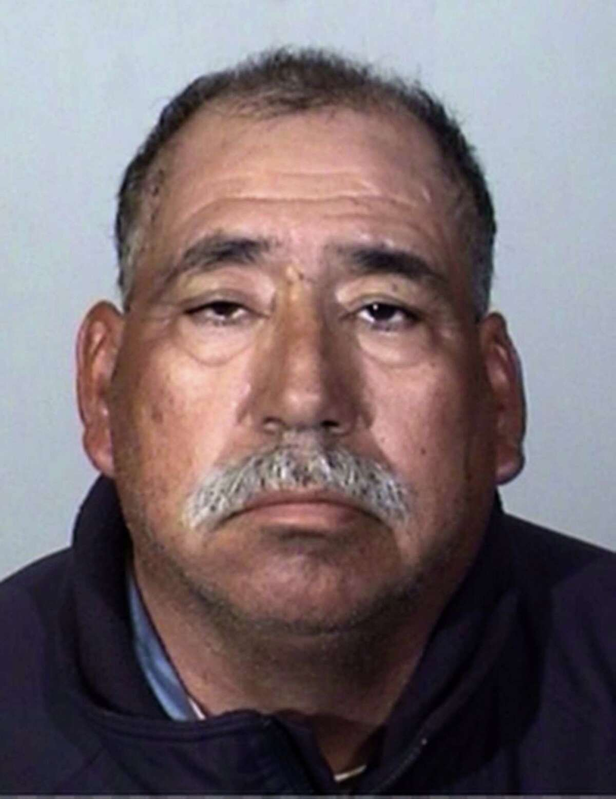 This Tuesday, Feb. 24, 2015 booking photo provided by the Oxnard Police Department shows Jose Alejandro Sanchez-Ramirez, 54, of Yuma, Arizona, who was the driver of a pickup truck that a Southern California commuter train smashed into on Tuesday, Feb. 24, 2015. He was found about a half-mile away from the crash 45 minutes later, said Jason Benites, an assistant chief of the Oxnard Police Department. Sanchez-Ramirez was briefly hospitalized before being arrested Tuesday afternoon on suspicion of felony hit-and-run. (AP Photo/Oxnard Police Department)