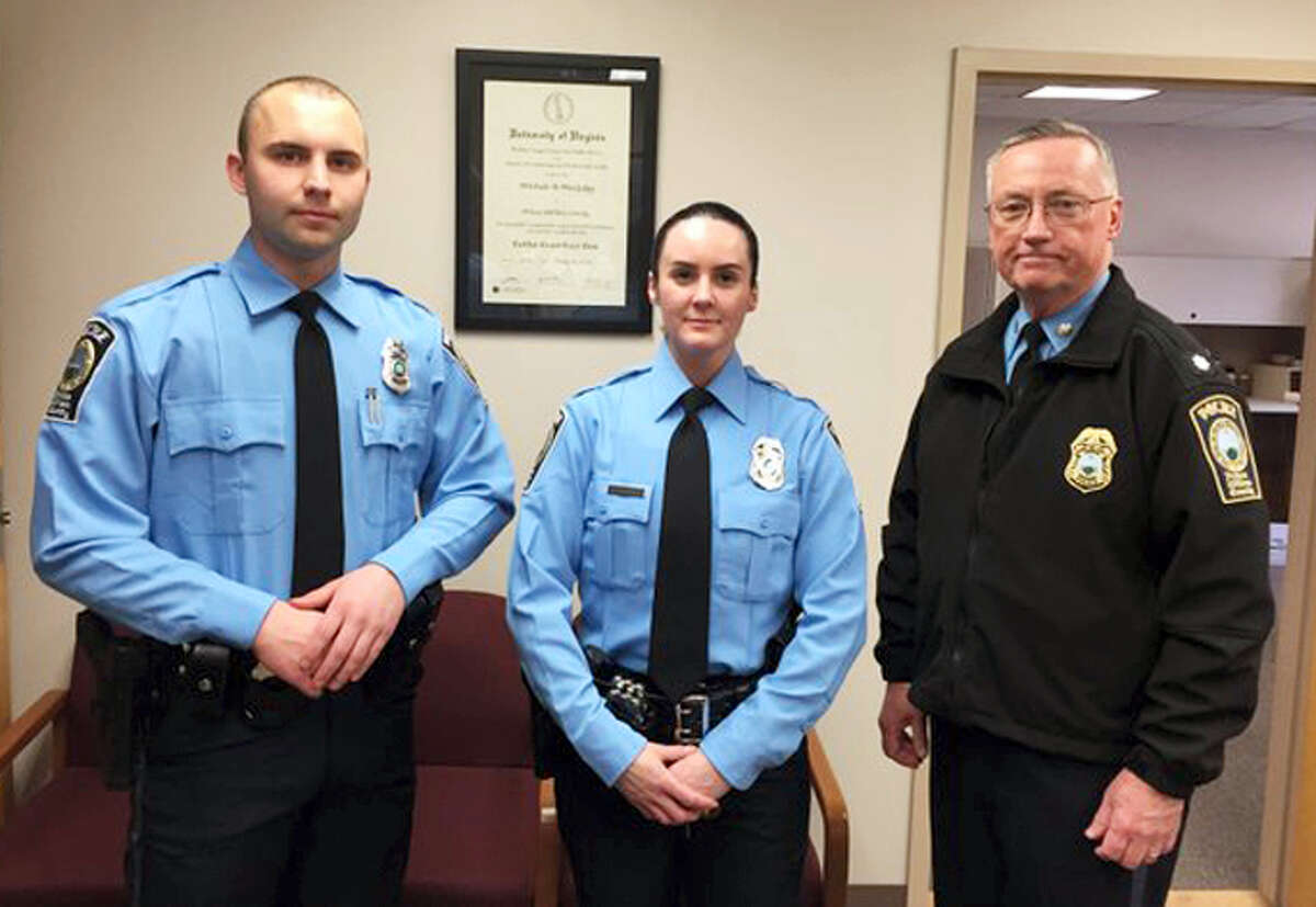 Prince William County Police Department via AP A photo provided by the Prince William County Police Department shows, from the left, Officer Steven Kendall, Officer and Ashley Guindon with Lt. Col. Barry Bernard, deputy chief of the Prince William County, Va., Police Department. Officer Ashley Guindon was shot and killed on Feb. 28, 2016 and two of her colleagues were wounded in a confrontation stemming from a call about an argument. Guindon and Kendall were sworn in on Friday, and Guindon was working her first shift with the Prince William County Police Department when she was killed.