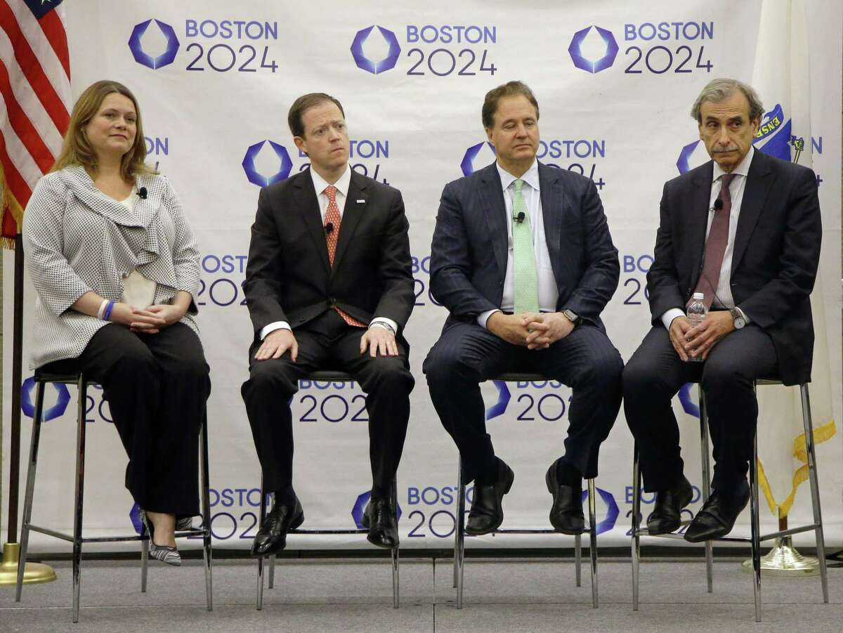 From left, Boston 2024 Partnership Chief Operating Officer Erin Murphy, Chief Executive Office Rich Davey, Chairman and Boston Celtics co-owner Steve Pagliuca and architect David Manfredi listen to a reporter's question during a media availability after they released the updated plans for the Olympic and Paralympic games at the Boston Convention and Exhibition Center on Monday.