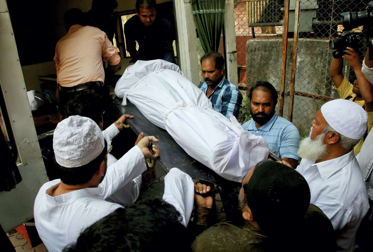 People carry the body of Indian man Hasnain Warekar, after autopsy from a hospital in Thane, outskirts of Mumbai, India on Feb. 28, 2016. Warekar, 35, fatally stabbed 14 members of his family, including seven children, early Sunday before hanging himself, police said.