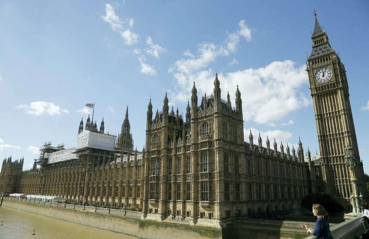 General view of the Houses of Parliament with scaffolding erected around a section of it in London, Thursday, Sept. 8, 2016. A committee charged with stopping Britain's creaky, leaky Parliament from falling down is set to say whether lawmakers will have to move out for several years so repair work can be done. The Joint Committee on the Palace of Westminster has been studying options for the 19th-century complex, which needs work to repair collapsing roofs, crumbling walls and leaking pipes, and to remove asbestos. (