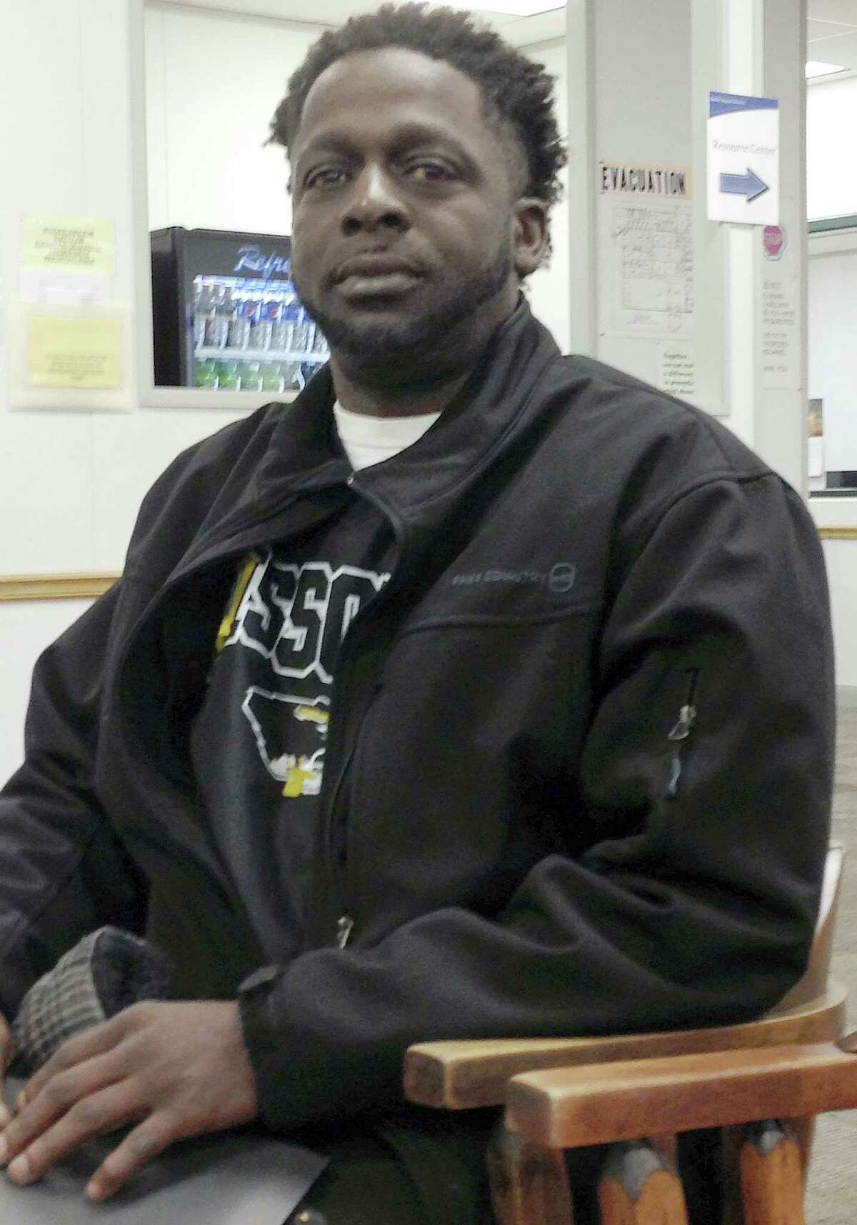In this Feb 8, 2016 photo, Demetrius White sits in a chair at a state career center in Jefferson City, Mo. White, who is receiving unemployment benefits, had gone to the center to get information about temporary job agencies. He is among the first group of unemployed workers in Missouri whose maximum benefits were cut from 20 weeks to 13 weeks under a state law that took effect in January.