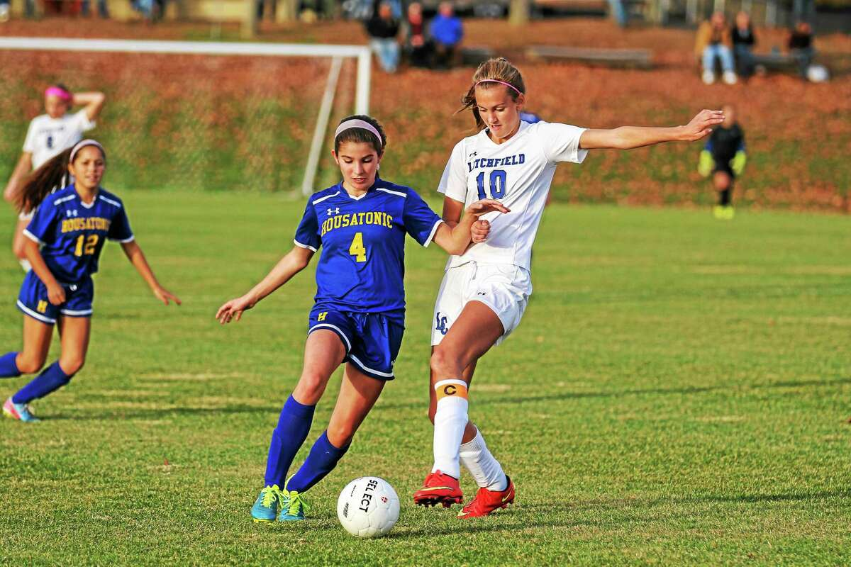 Litchfield's Elena Kenndy attempts to take control of the ball from Josie Horosky of Housatonic.