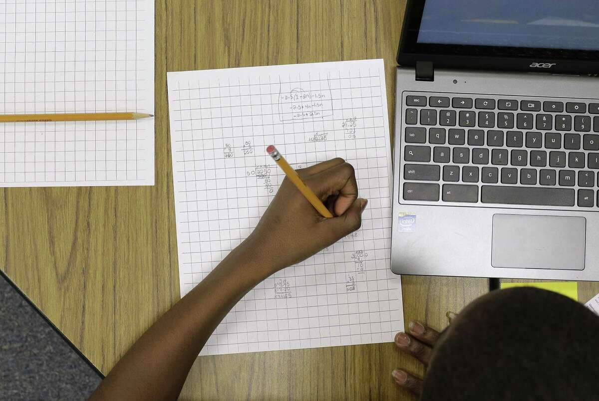 In this Feb. 12 photo, Yamarko Brown, 12, works on math problems as part of a trial run of a new state assessment test at Annapolis Middle School in Annapolis, Md. The new test, which is scheduled to go into use March 2, is linked to the Common Core standards, which Maryland adopted in 2010 under the federal No Child Left Behind law.