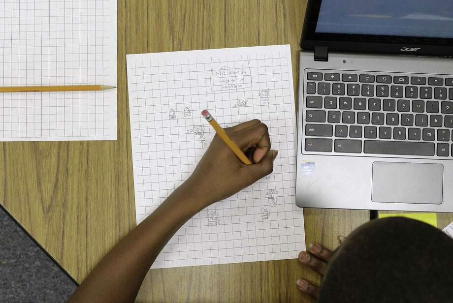 In this Feb. 12 photo, Yamarko Brown, 12, works on math problems as part of a trial run of a new state assessment test at Annapolis Middle School in Annapolis, Md. The new test, which is scheduled to go into use March 2, is linked to the Common Core standards, which Maryland adopted in 2010 under the federal No Child Left Behind law. Photo: AP Photo  / AP