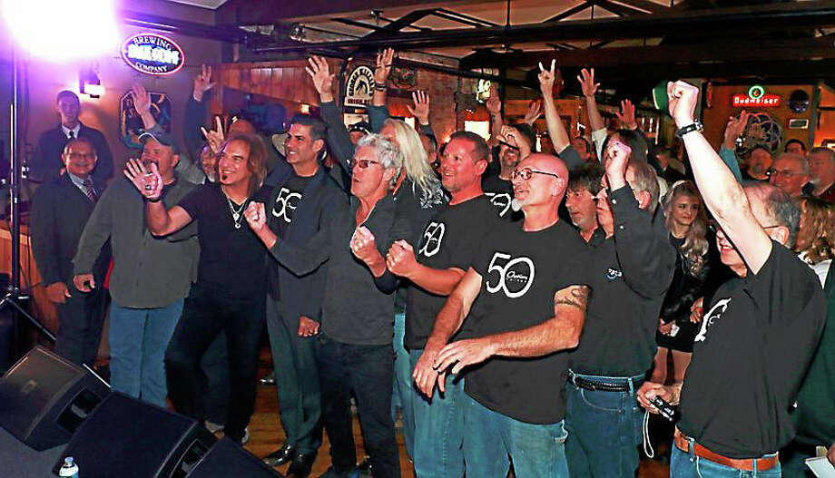 Members of REO Speedwagon, employees of Drum Workshop Inc. and fans celebrate the formal re-launch of production at Ovation Guitars in New Hartford. The event took place at The Parrott Delaney Tavern, located across the lot from Ovation at the Hurley Business Park on Greenwoods Road. Photo: John Fitts -- The Register Citizen