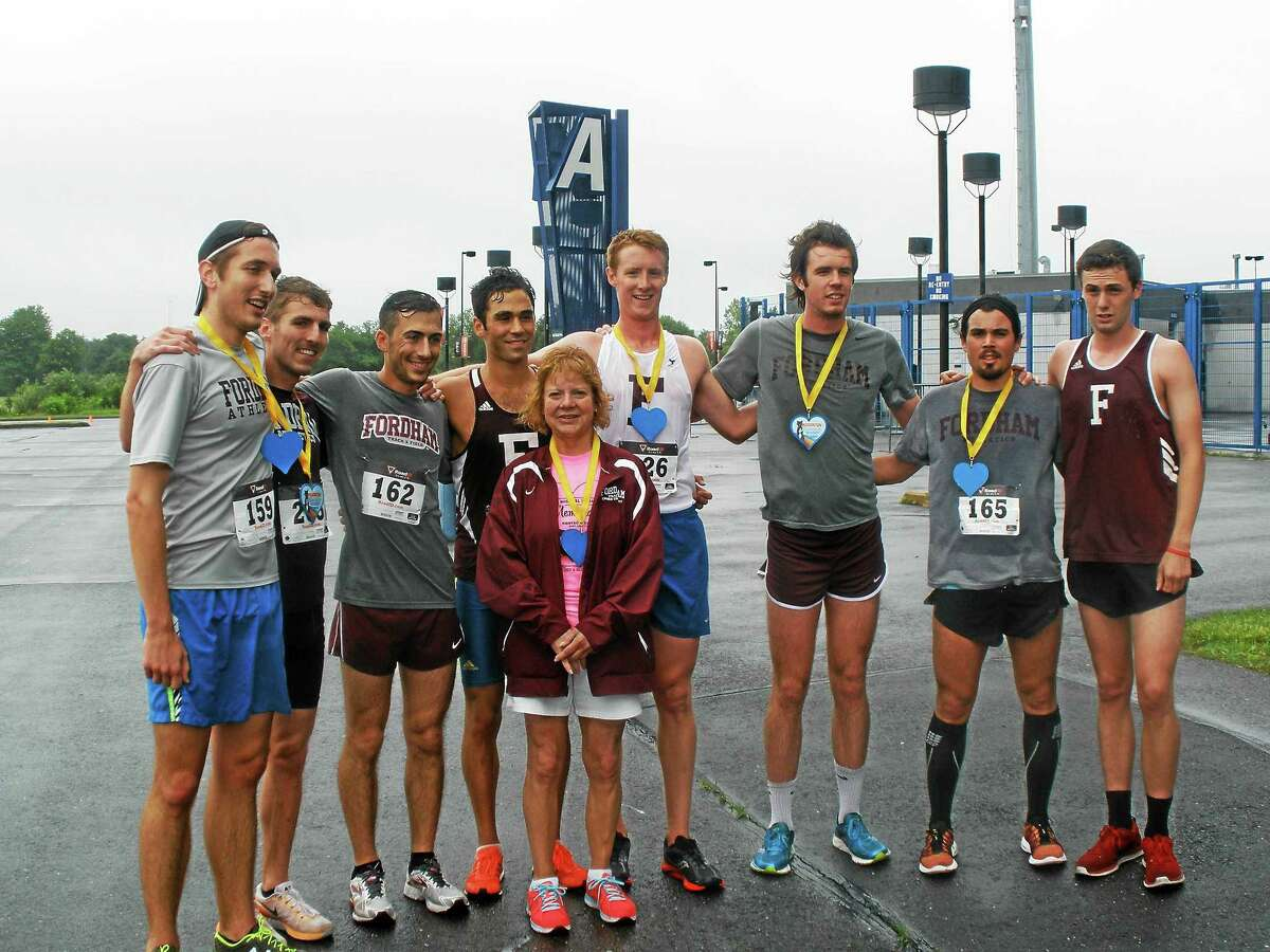 Stephen Underwood -- REGISTER-CITIZEN Mary Ann Walsh along with runners from Fordham University taking part in the Michael E. Walsh Memorial 5K Race Sunday.