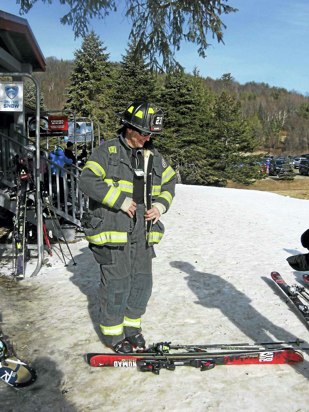 John Torsiello photo Allan Lewis of the winning Danbury Fire Department team gets prepared for Sunday's Mohawk Mountain Firefighter Race.