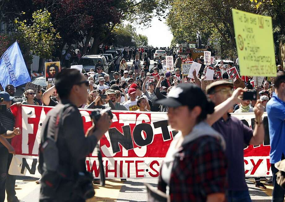 Protesters gather on Steiner Street outside of Alamo Square Park in San Francisco, Calif. on Saturday, August 26, 2017. Photo: Scott Strazzante, The Chronicle