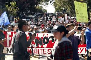 Protesters gather on Steiner Street outside of Alamo Square Park in San Francisco, Calif. on Saturday, August 26, 2017.