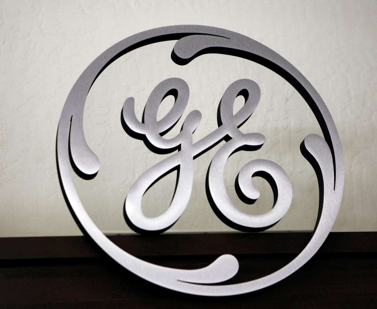 A General Electric (GE) sign is seen on display at Western Appliance store in Mountain View, Calif.