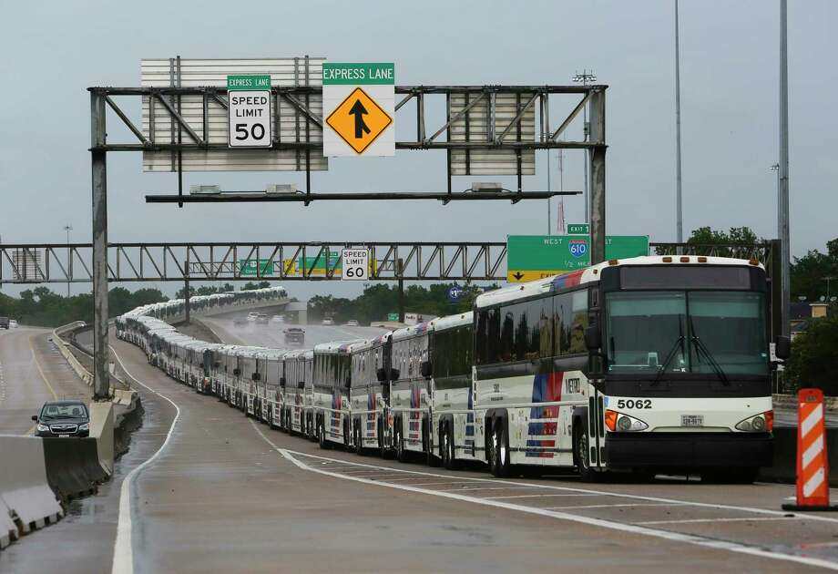 As a preventative measure empty Metro buses are lined up in the center lanes of Interstate 59 near Cavalcade in case their bus shelters flood, Saturday, Aug. 26, 2017, in Houston. Photo: Mark Mulligan, Houston Chronicle / 2017 Mark Mulligan / Houston Chronicle