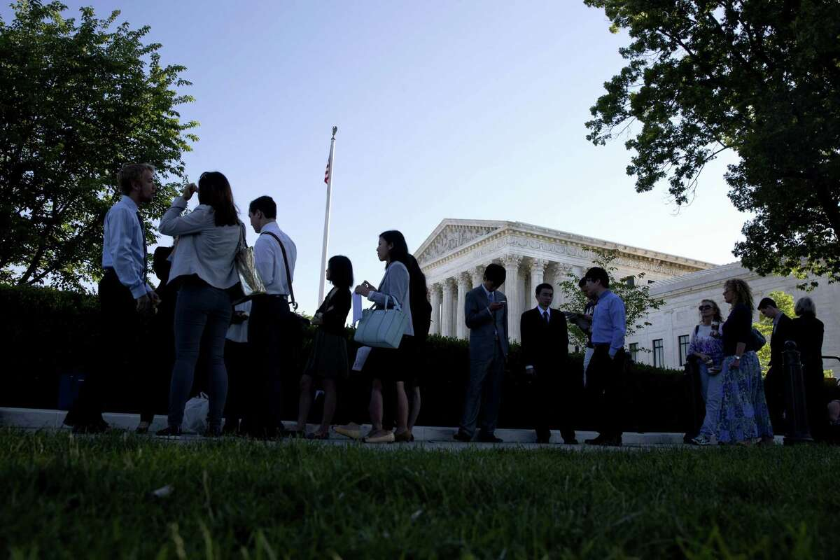 People stand in line hoping to enter the Supreme Court in Washington on Monday, June 29, 2015. The Supreme Court is meeting for the final time until the fall to decide three remaining cases and add some new ones for the term that starts in October.