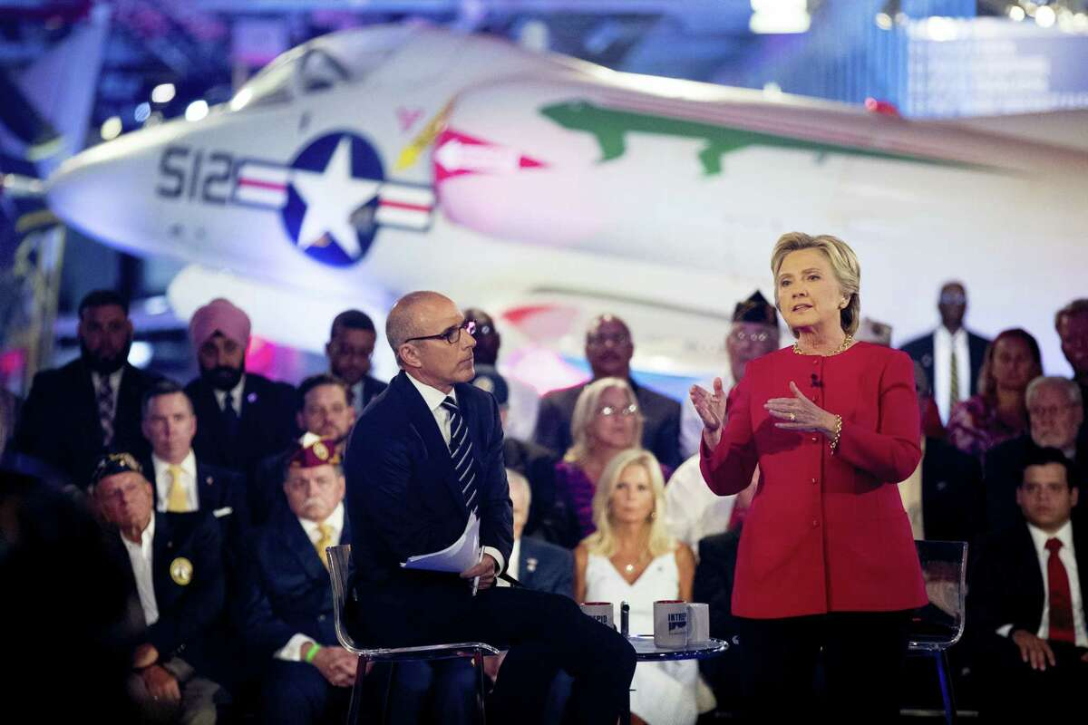 Democratic presidential candidate Hillary Clinton, with 'Today' show co-anchor Matt Lauer, left, speaks at the NBC Commander-In-Chief Forum held at the Intrepid Sea, Air and Space museum aboard the decommissioned aircraft carrier Intrepid, New York on Sept. 7, 2016.