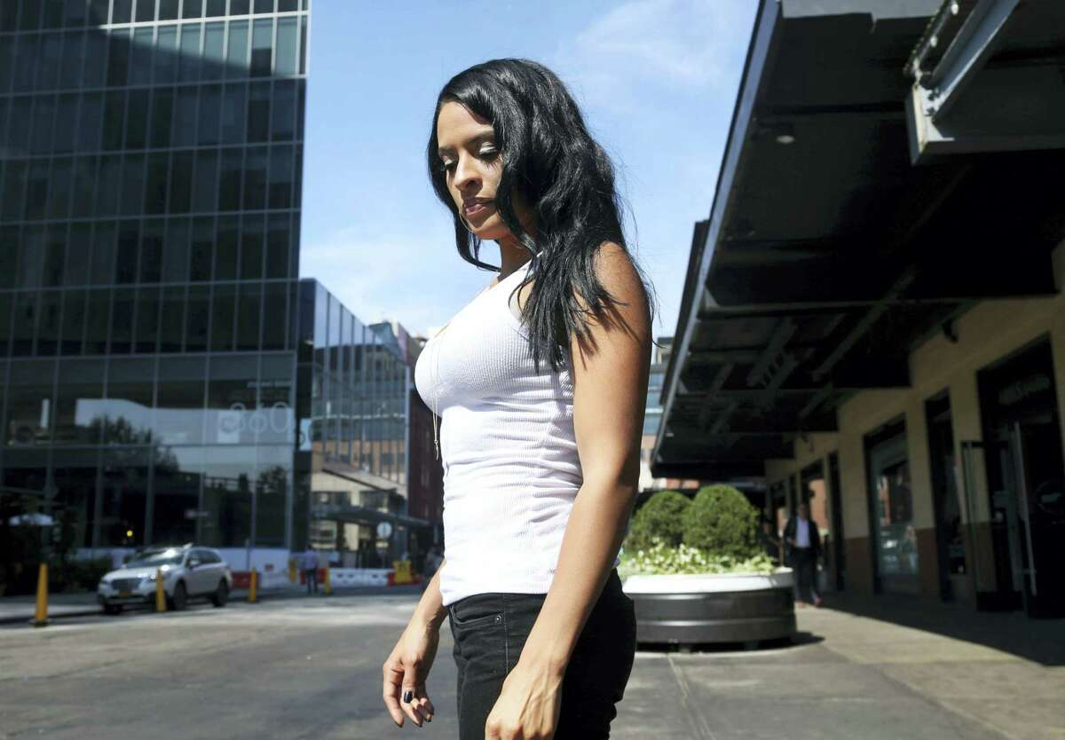 Thea Trinidad poses for a photo in New York on Aug. 9, 2016. She was 10 when she overheard her father calling her mother to say goodbye from the trade center's north tower, where he worked as a telecommunications analyst.