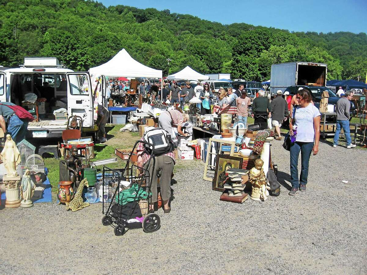 The crowd grows on a sunny Sunday afternoon at Elephant's Trunk flea market in New Milford.