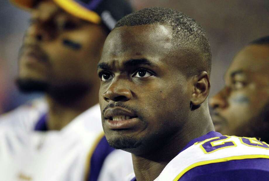 A federal judge has cleared the way for Adrian Peterson to be reinstated. Photo: Charles Rex Arbogast — The Associated Press File Photo  / AP