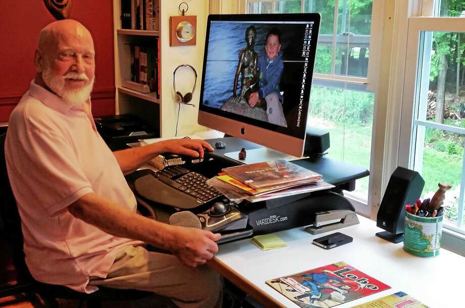 DJ Arneson works in his home office in Woodbury. Photo: Photo By N.F. Ambery