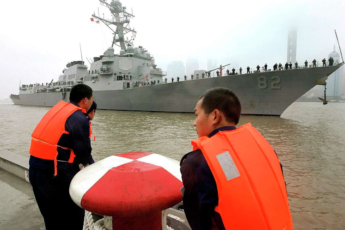In this April 8, 2008, file photo, Chinese navy personnel get ready for U.S. Navy guided missile destroyer USS Lassen to dock at the Shanghai International Passenger Quay in Shanghai, China, for a scheduled port visit. The USS Lassen sailed past one of China's artificial islands in the South China Sea on Tuesday, Oct. 27, 2015, in a challenge to Chinese sovereignty claims that drew an angry protest from Beijing, which said the move damaged US-China relations and regional peace.