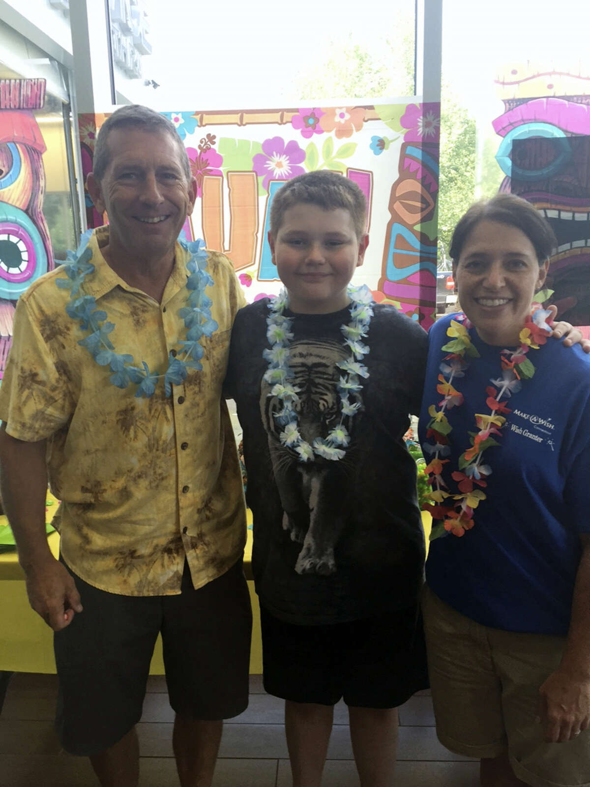 Contributed photo Center Subaru in Torrington hosted a Wish Delivery party for Wish Kid, Robert,center, who wished to go to Hawaii.