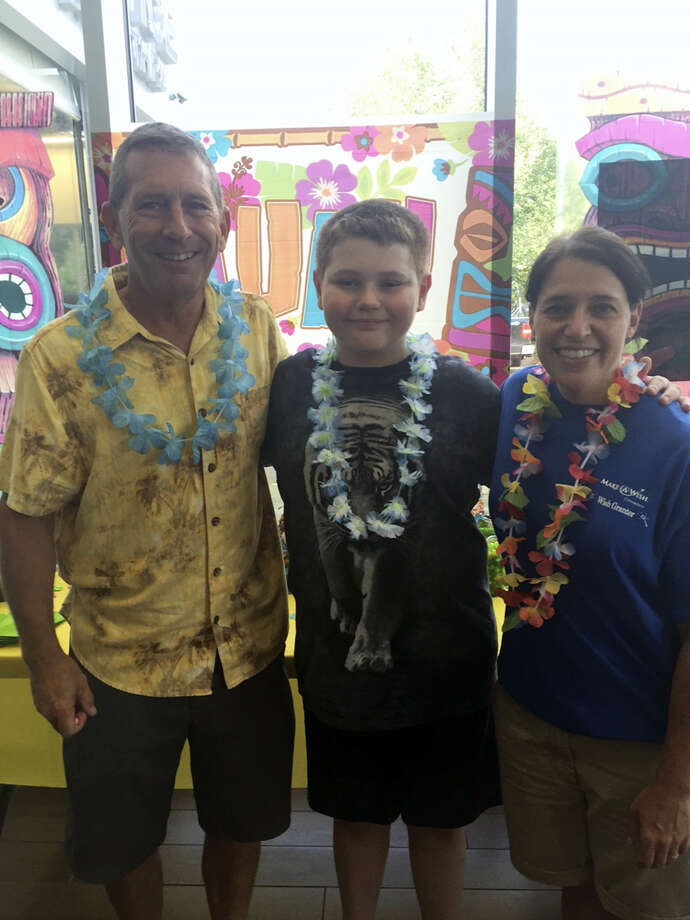 Contributed photo Center Subaru in Torrington hosted a Wish Delivery party for Wish Kid, Robert,center, who wished to go to Hawaii. Photo: Journal Register Co.