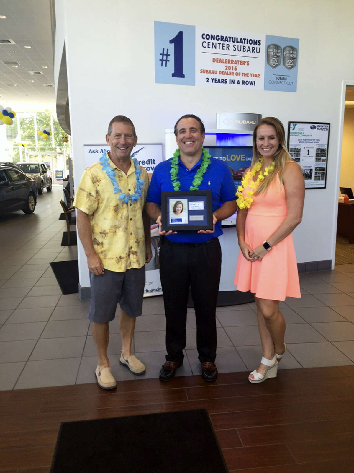 Contributed photo Center Subaru in Torrington hosted a Wish Delivery party for Wish Kid, Robert, who wished to go to Hawaii. Above, family and Subaru staff gather for a photo.