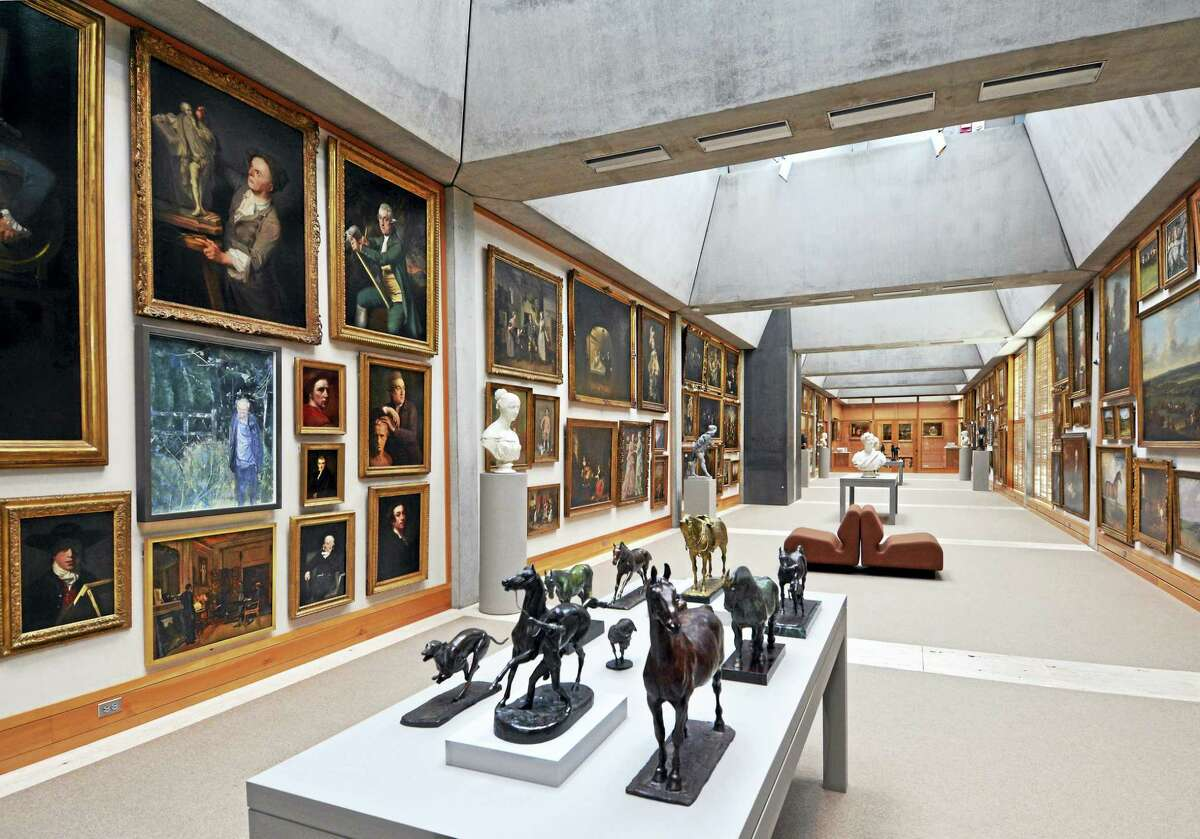 The Long Gallery, with its dense hang of paintings.