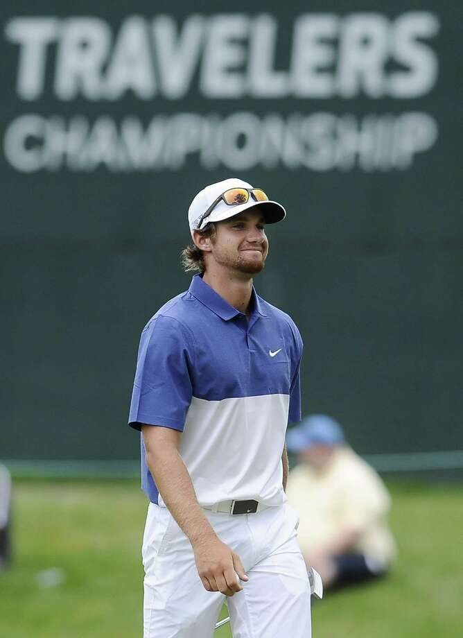 Patrick Rodgers reacts to a birdie putt on the 17th hole during the third round of the Travelers Championship on Saturday in Cromwell. Photo: Jessica Hill — The Associated Press  / FR125654 AP