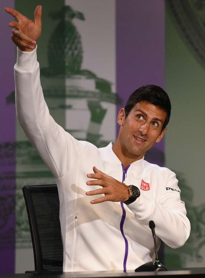 Novak Djokovic gestures during a press conference at the All England Lawn Tennis and Croquet Club on Sunday in London. Photo: Adam Davy — The Associated Press  / PA