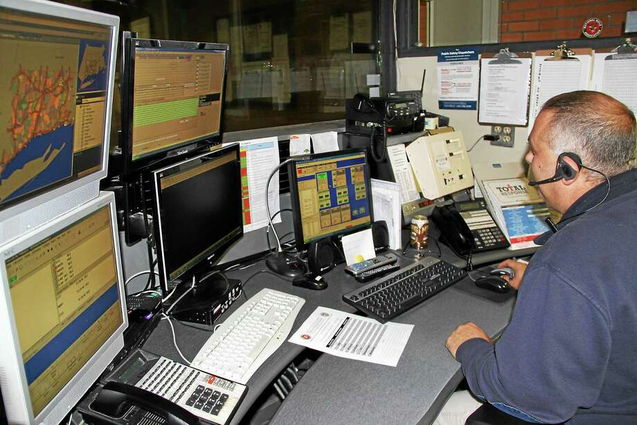 Winsted police dispatcher Philip Bascetta at the controls of the town's emergency communication system. Photo: Manon L. Mirabelli — The Register Citizen