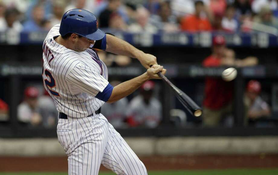 Mets pitcher Steven Matz hits a two-run double during the second inning of Sunday's game against the Cincinnati Reds at Citi Field in New York. Photo: Seth Wenig — The Associated Press  / AP