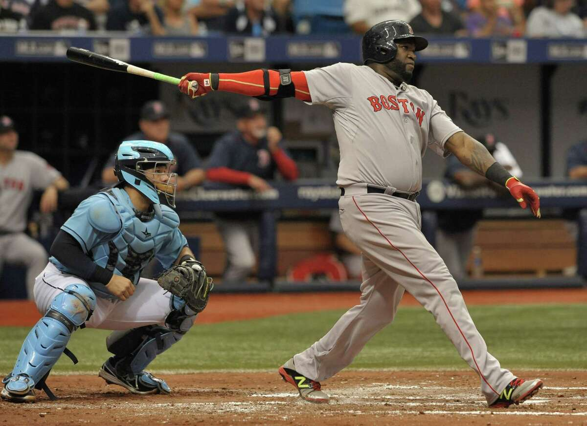 Tampa Bay Rays catcher Rene Rivera looks on as Boston Red Sox DH David Ortiz hits a two-run home run in the fourth inning of Sunday's game in St. Petersburg, Fla.