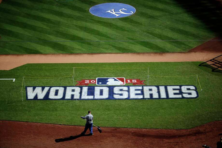 A worker gets Kauffman Stadium ready for the World Series Monday in Kansas City, Mo. Photo: David Goldman — The Associated Press  / AP
