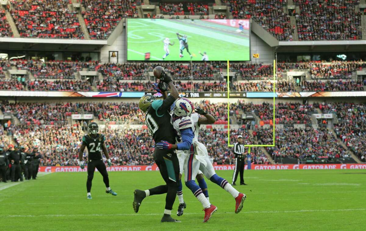 Jacksonville Jaguars tight end Julius Thomas fails to make a catch as he is challenged by Buffalo Bills free safety Corey Graham on Sunday at Wembley Stadium in London.