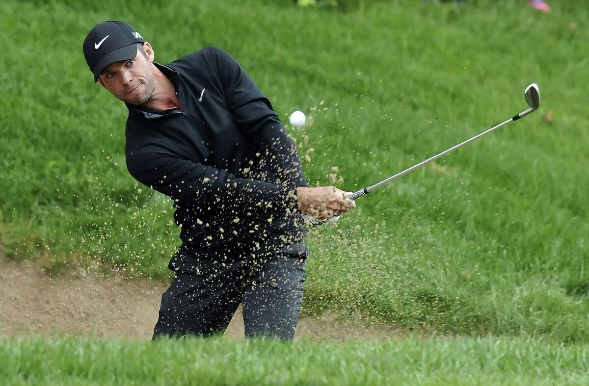 Paul Casey hits out of a sand trap on 18th during the first playoff hole on Sunday at the Travelers Championship in Cromwell.