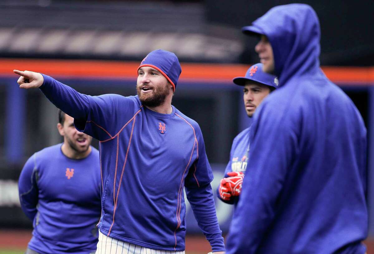 Mets second baseman Daniel Murphy, left, talks with teammates during a workout Saturday in New York.