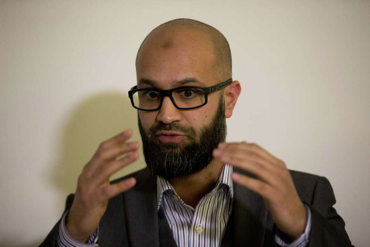 CAGE research director Asim Qureshi talks during a press conference held by the CAGE human rights charity in London, Thursday, Feb. 26, 2015. A British-accented militant who has appeared in beheading videos released by the Islamic State group in Syria bears ìstriking similaritiesî to a man who grew up in London, a Muslim lobbying group said Thursday. Mohammed Emwazi has been identified by news organizations as the masked militant more commonly known as ìJihadi John.î London-based CAGE, which works with Muslims in conflict with British intelligence services, said Thursday its research director, Asim Qureshi, saw strong similarities, but because of the hood worn by the militant, ìthere was no way he could be 100 percent certain.î (AP Photo/Matt Dunham)