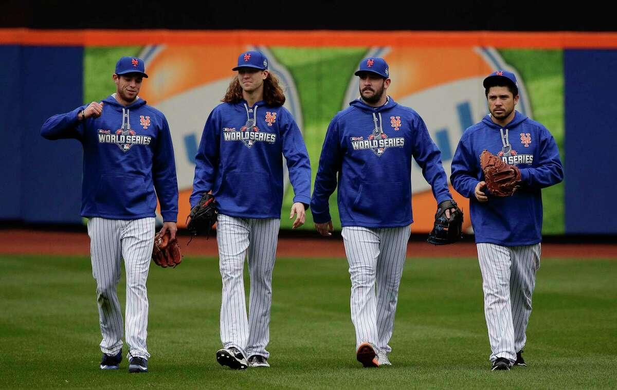 From left, New York Mets pitchers Steven Matz, Jacob deGrom and Matt Harvey and catcher Travis d'Arnaud walk off the field Saturday in New York.