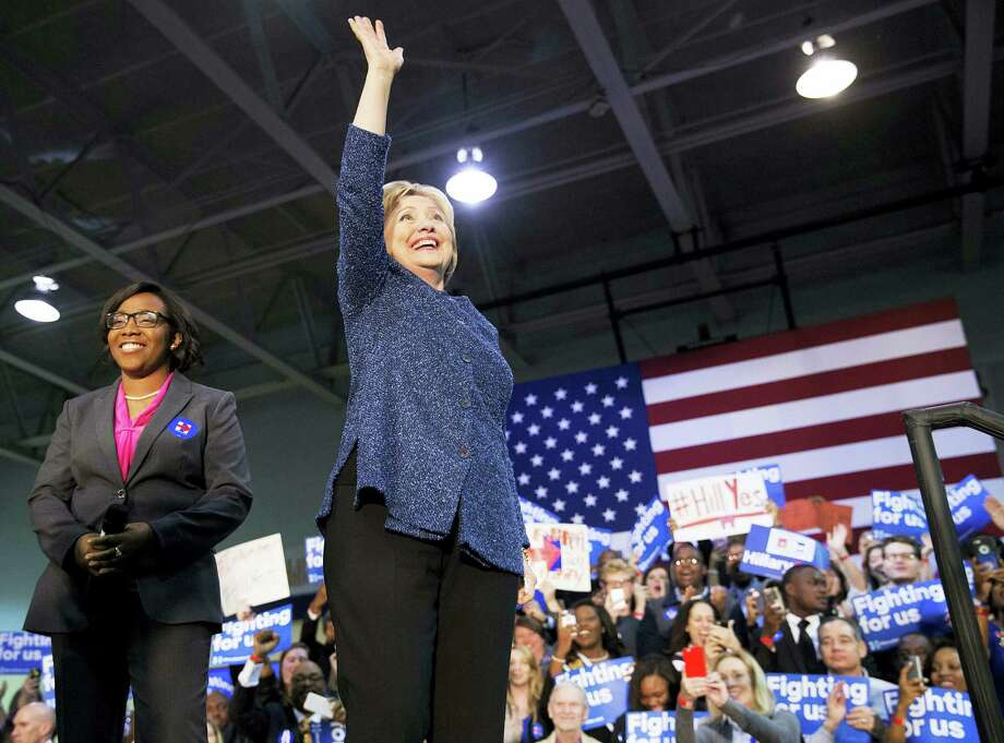 Democratic presidential candidate, Hillary Clinton, right, waves to the crowd as she takes the stage for a campaign event at Miles College as Jynae Jones, president of the student government association looks on Saturday, Feb. 27, 2016, in Fairfield, Ala. Photo: AP Photo/David Goldman   / AP