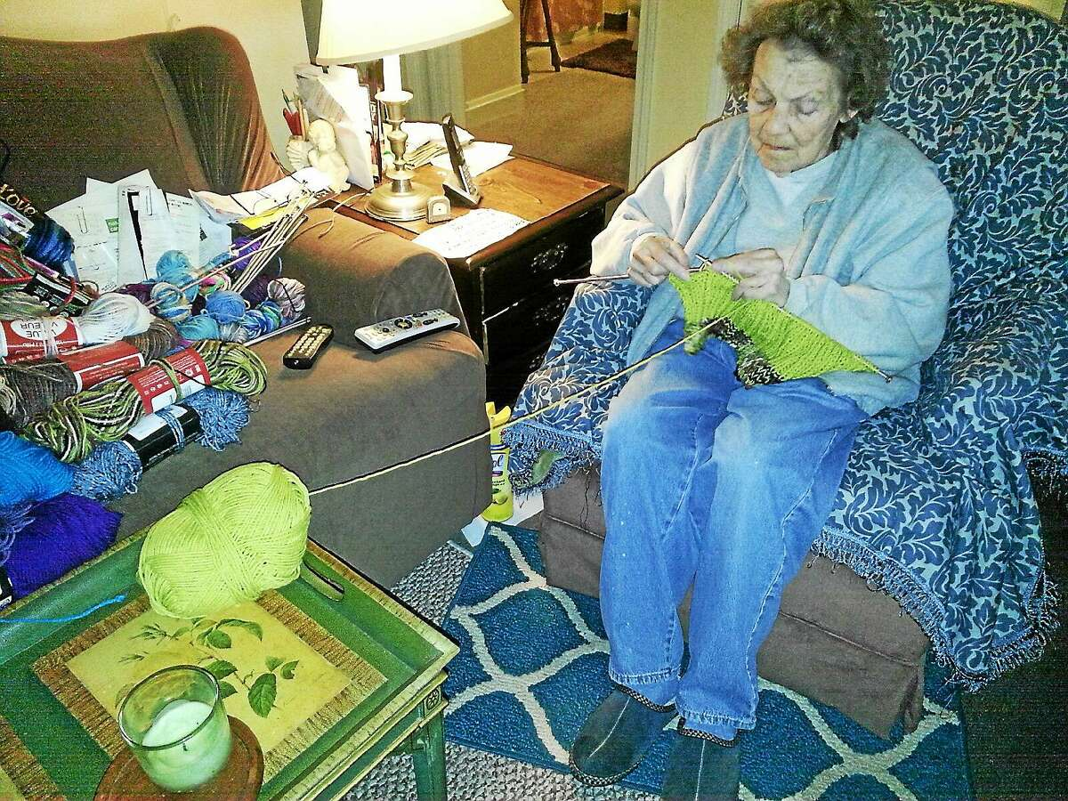 Tessie Martinotti, of Morris, has been knitting hundreds of scarves and hats and donating them.