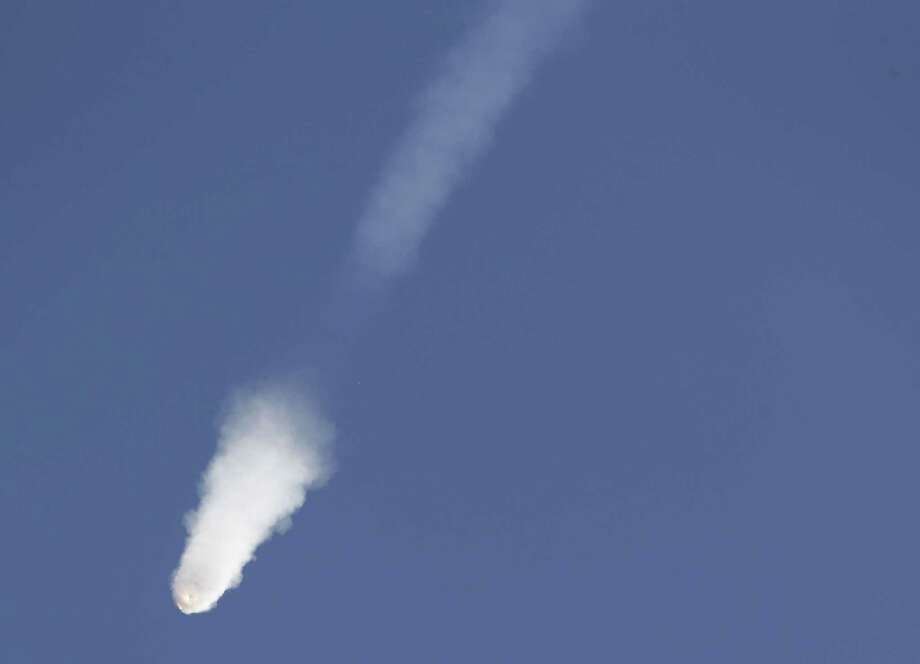 The SpaceX Falcon 9 rocket and Dragon spacecraft breaks apart shortly after liftoff from the Cape Canaveral Air Force Station in Cape Canaveral, Fla., Sunday, June 28, 2015. The rocket was carrying supplies to the International Space Station. Photo: AP Photo/John Raoux  / AP